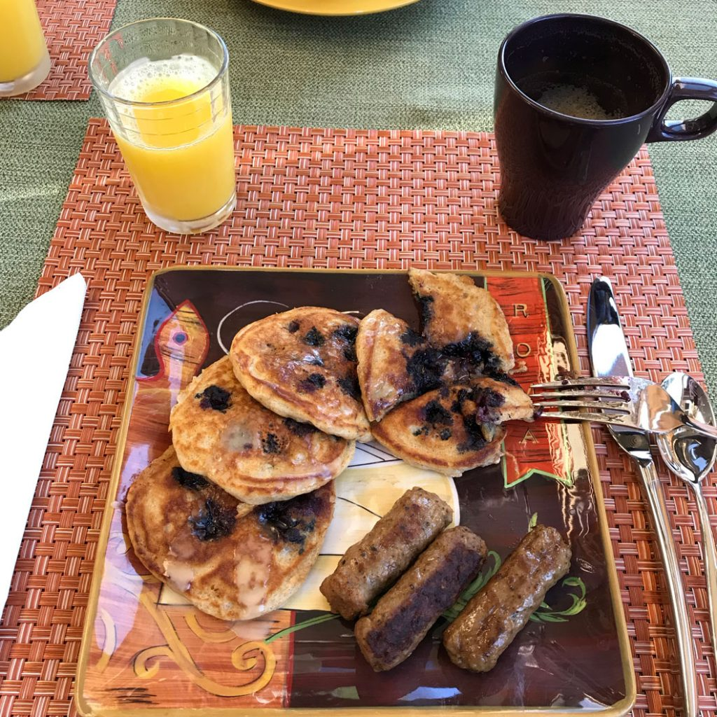 breakfast plate with huckleberry pancakes and turkey sausages